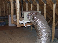 picture of attic air handler supported from trusses