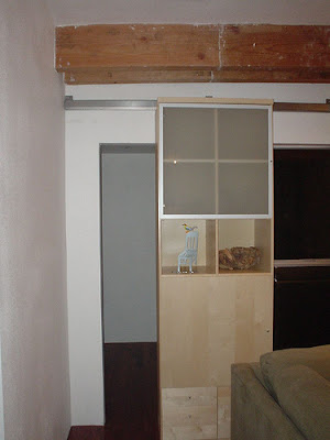bookcase sliding door open
