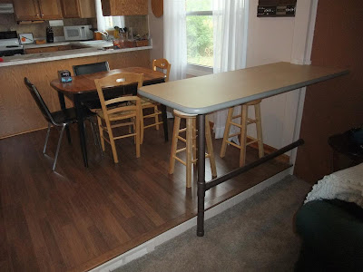 separate rooms with bar, island, counter top