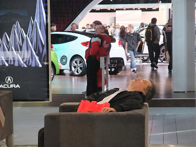 guy sleeping at the auto show