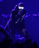 Kanye West goes dark and glowy