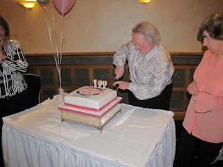 Nan Blair cuts the cake