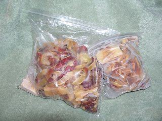 Bags of frozen apple peels and cores for fruit scrap jelly.
