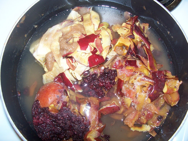 Apple peels, peach and plum scraps and a few blackberries combine to make fruit scrap jelly.