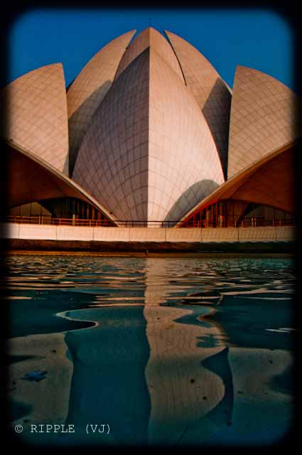 A good place to visit in Delhi : Lotus Temple @ Nehru Place, Delhi, INDIA: Here are some some miscellaneous shots of Lotus Temple. The construction of the temple is similar to that of the Opera House in Sydney. The temple always looks mesmerizing. However, different light conditions have different effect on the way the temple appears.: Posted by Ripple (VJ) on PHOTO JOURNEY @ www.travellingcamera.com : ripple, Vijay Kumar Sharma, ripple4photography, Frozen Moments, photographs, Photography, ripple (VJ), VJ, Ripple (VJ) Photography, Capture Present for Future, Freeze Present for Future, ripple (VJ) Photographs , VJ Photographs, Ripple (VJ) Photography : Reflection of the temple in the clear, shimmering water of the pond.@ LOTUS TEMPLE, Nehru Place, Delhi, INDIA