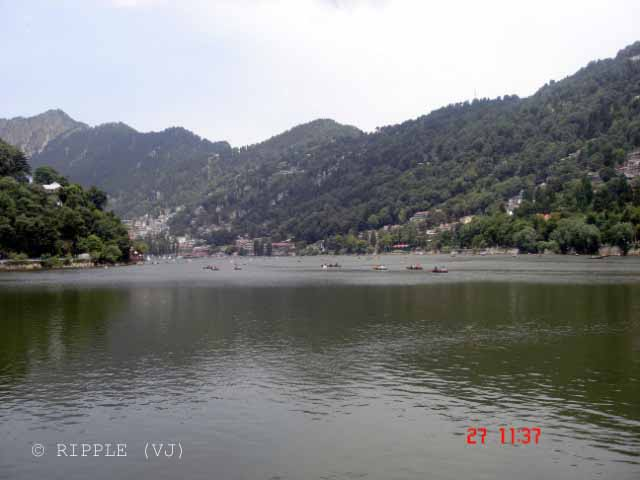 Naini Lake @ Uttrakhand, INDIA: Posted by VJ on PHOTO JOURNEY @ www.travellingcamera.com : VJ, ripple, Vijay Kumar Sharma, ripple4photography, Frozen Moments, photographs, Photography, ripple (VJ), VJ, Ripple (VJ) Photography, VJ-Photography, Capture Present for Future, Freeze Present for Future, ripple (VJ) Photographs , VJ Photographs, Ripple (VJ) Photography, Naianitaal, Uttranahcal. Uttrakhand, INDIA, People, North India : The north end of lake is called Mallital while the southern one is called Tallital which have a bridge having Gandhiji's statue and post office on its side...