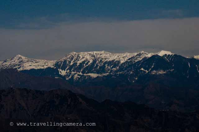 View of Peer Panjal Mountain Range from Dalhousie @ Himachal Pradesh, INDIA : Posted by VJ SHARMA at www.travellingcamera.com : Pir Panjal Range is a mountain range in the Middle Himalayas running from east south east to west north west across the states of Himachal Pradesh and Indian administered Kashmir in the Republic of India as well as Pakistan administered Kashmir... All these photographs have been clicked during one of m Dalhousie trip... Dalhousie Mall Road has amazing views to PIR PANJAL mountain range... Here are few photographs of PIR PANJAL which are clicked from Mall Road @ Dalhousie, Chamba, Himachal Pradesh, INDIA Dalhousie Mall road starts from Subhash chowk and this photograph has been clicked after few minutes of walk from Subhash Chowk.. towards main market of Dalhousie, also known as Gandhi Chowk...The eastern segment of the range forms the watershed that separates the Chenab (Chandrabhaga) river basin from the Beas and Ravi river basins...Zoomed view of PIR PANJAL from middle of the Mall Road @ Dalhousie, Chamba, Himachal Pradesh... I have used Nikon D90 with 18-200mm to click all these photograph.. and most of them are clicked in the evening....Rohtang La is a mountain pass on the eastern Pir Panjal range. It connects Manali in the Kullu Valley to Keylong in the Lahaul Valley. ..This is clicked from Gandhi Chowk and the green hill on the right is the one where Dalhousie Public School is situated... Its very popular boarding school in Himachal Pradesh...Haji Pir Pass is a mountain pass on the western Pir Panjal range between Poonch and Uri (India).Haji Pir Pass is an important outpost manned by the Pakistan Army. The pass witnessed Pakistani aggression during both the 1965 and 1971 wars. India captured this pass in the 1965 war due to lack of Pakistani strength in that area and was later returned to Pakistan during exchange of each others territories. During the 1971 war, Pakistan army repulsed to Indian attacks on the post. This pass today continues to be part of Pakistan Occupied Kashmir...Clouds moving up from PIR PANJAL mountains... and let me share that Dalhousie gets heavy rainfall in himachal pradesh ... snowfall also...Deo Tibba (6001 m) and Indrasan (6221 m) are two important peaks at the eastern end of the mountain range. They can be approached from both the Parbati-Beas Valley (Kulu District) and the Chandra (Upper Chenab) Valley (Lahaul and Spiti District) in the Indian state of Himachal Pradesh.The hill stations of Gulmarg in the Indian state of Jammu and Kashmir lies in this range.