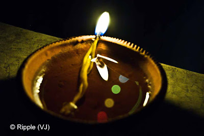 Posted by Ripple (VJ) : Diwali Celebrations 2008 (Indian Festivals of Lights): Diya with reflections of colorful lights on roof-boundary