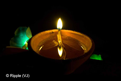 Posted by Ripple (VJ) : Diwali Celebrations 2008 (Indian Festivals of Lights): Diya with symmetrical reflection