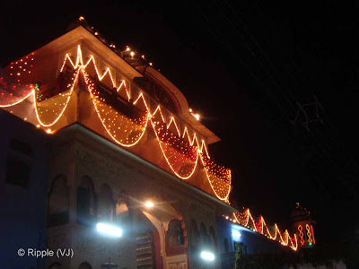 Posted by Ripple (VJ) : Pushkar Night View: Temple in the middle of Pushkar Market... Don't know the name :-)