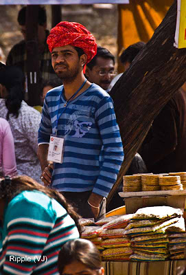 Posted by Ripple (VJ) : Faces of India @ Surajkund Fair : The Pagdi stands out in a Stark Antithesis to the t-shirt and jeans@ Surajkund Fair 2009