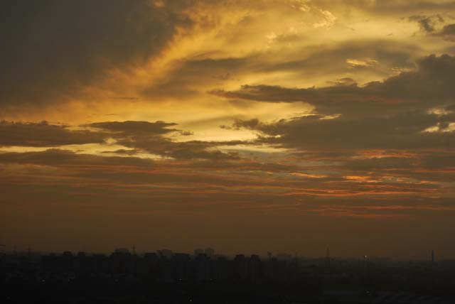 Sunset after heavy rains in Delhi - By Saurabh Gupta : Posted by VJ SHARMA at www.travellingcamera.com : Here are few photographs clicked by Saurabh Gupta from his Office terrace... (Noida)Its rare thing to have clear sky and get these colors during sunset... Normally there is lot of pollution and sky is not clear.. This time monsoons have flushed out all haziness from sky....Here is view of Sunset with Sector-21 apartments in the bottom...Its been more than one week we can clear and blue sky during day time... n these colors in the evening...Sunset color behind SPICE MALL in City Center of Noida....Colorful clouds look very angry and planning for showers during night...Another shot of the terrace during early time of the sunset...