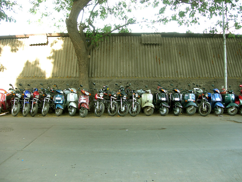 parked scooters at andheri station