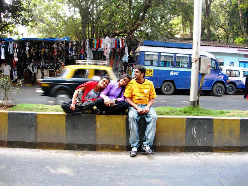 sitting on the road divider in churchgate mumbai