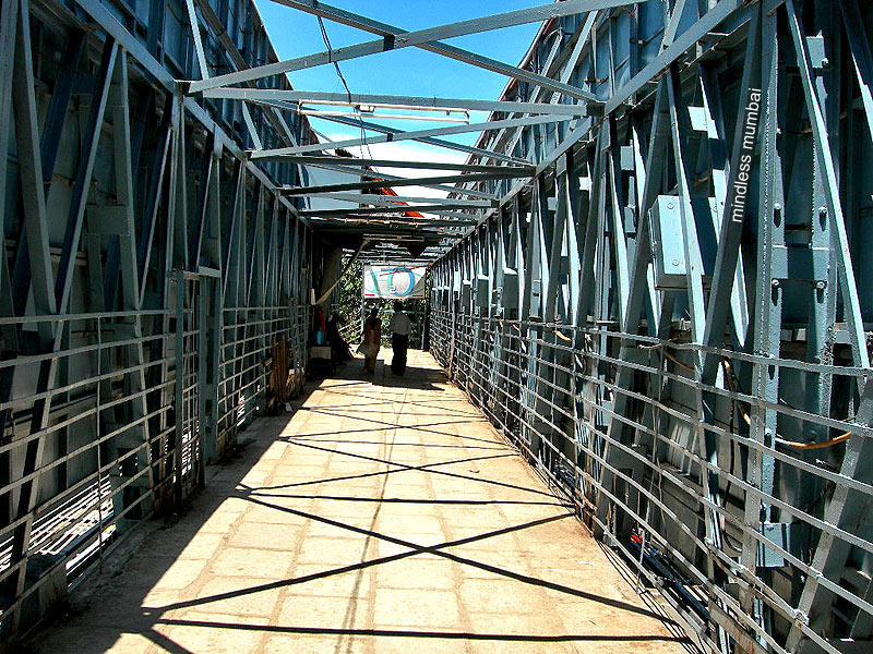 steel framed pedestrian foot over bridge at charni road, marine drive, mumbai