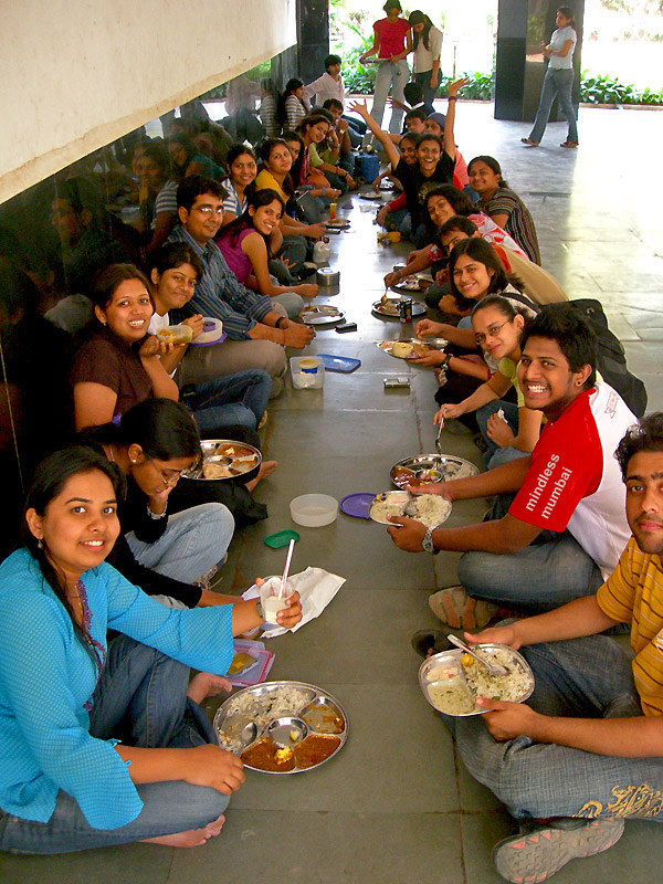 lunching with friends in a group in college