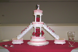 The Color Red Was Brides Chosen Hue Throughout Her Wedding She Chose Stairway Cake With Satellite Cakes For Special Day To Accomondate