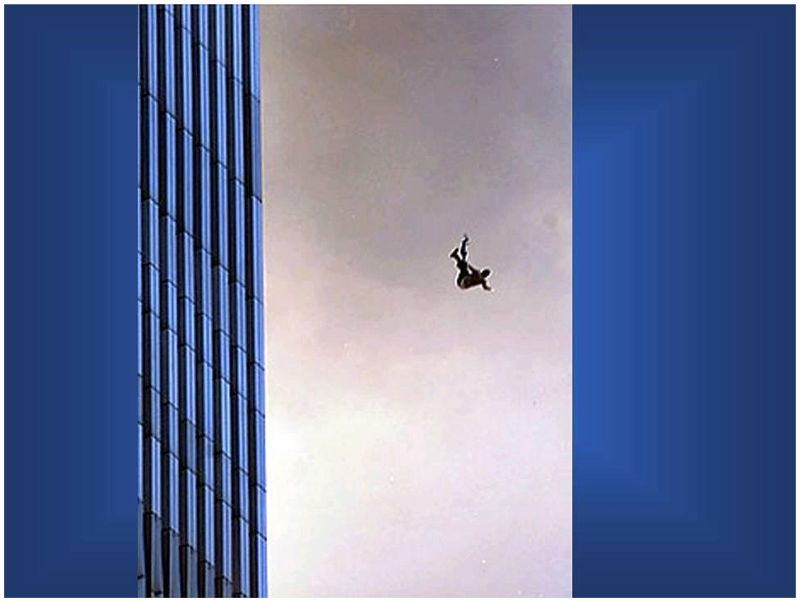 two people holding hands as they fall from the twin towers