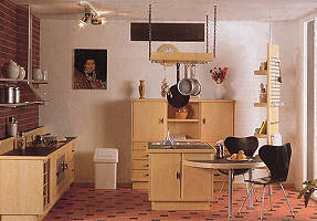 Modern miniature dolls' house kitchen in blonde wood with black details.