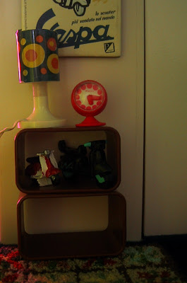 Modern dolls' house miniature stacking shelf units with mod lamps and clock on top.