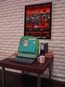 Modern dolls' house miniature office scene with iMac G3 computer.