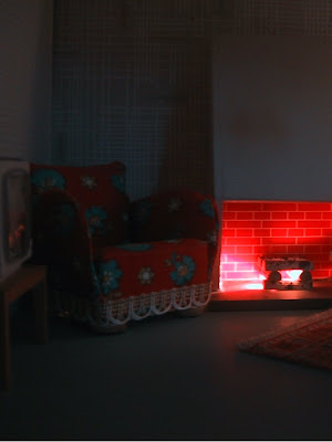 Vintage 1967 Lundby dollshouse lounge with fireplace lit up at night.