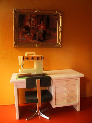 Vintage Lundby dolls' house desk with sewing machine on top.