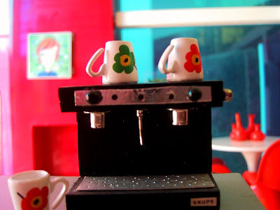 Modern miniature Kaleidoscope doll's house living room view from an espresso machine.