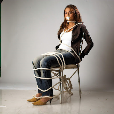 Hot and sexy Hindi film heroine Amrita Arora in a jeans tied on a chair in Hindi feature film TEAM - THE FORCE