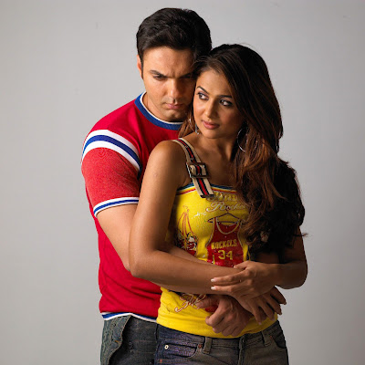 Actor Sohail Khan and actress Amrita Arora in a romantic pose for film TEAM - THE FORCE