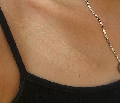 Best black tattoo ink dark skin for Red tattoo on brown skin