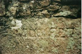 Data no muro da Igrexa de San Pedro de Outes