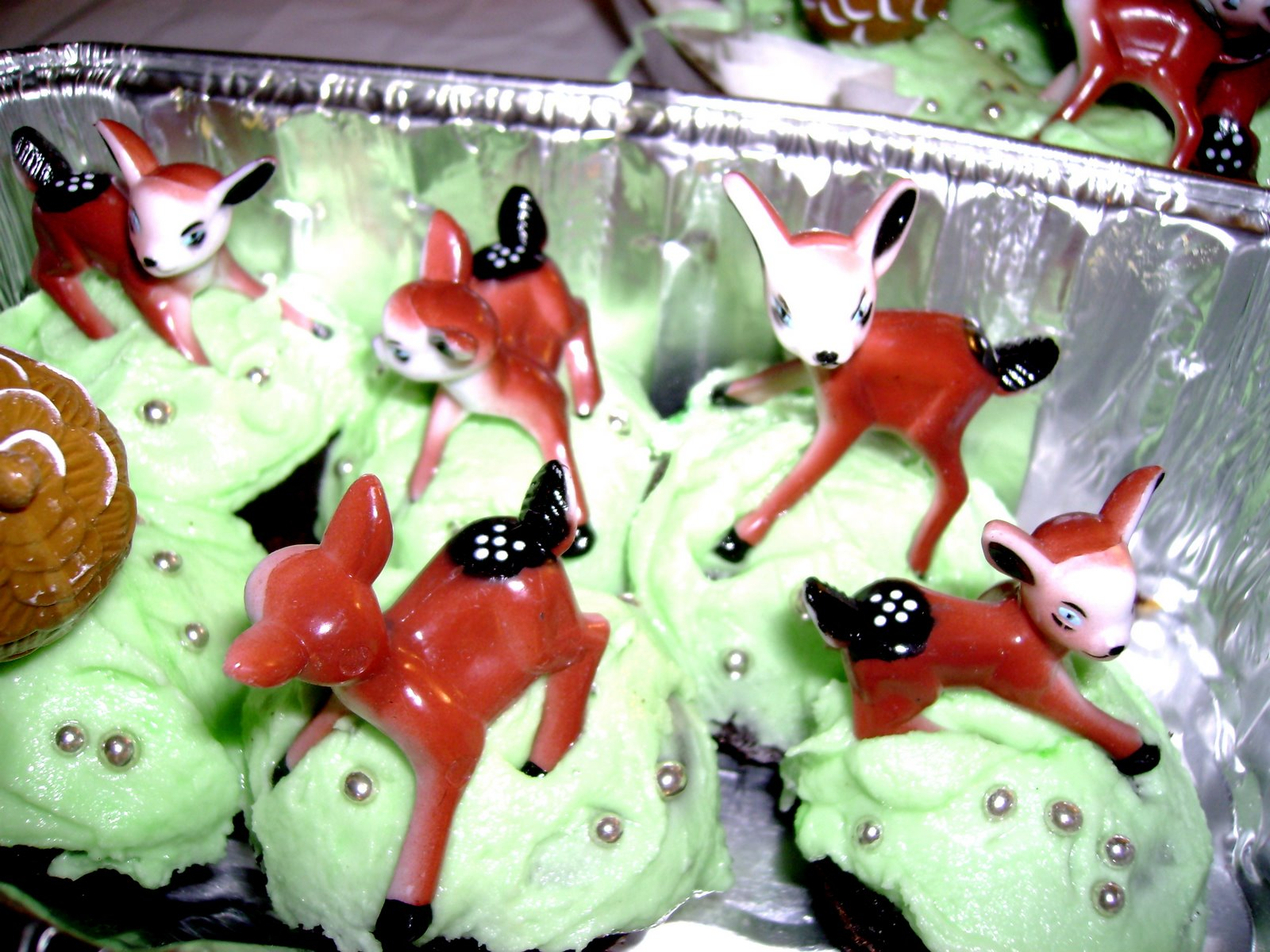 ... with mint green icing and vintage baby deer and pinecone cake toppers