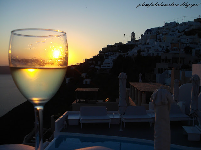 drinking white wine in Santorini