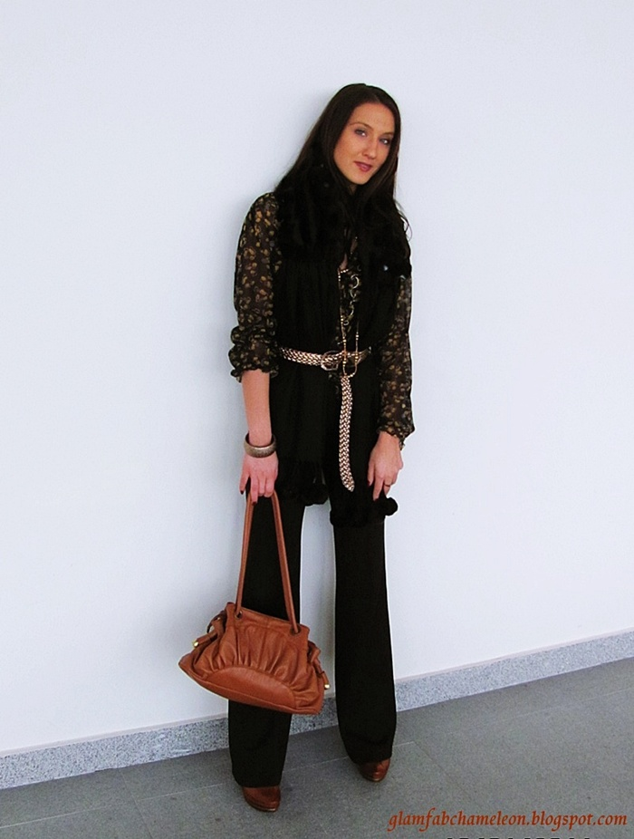 black wide leg pants, tan leather purse and shoes, black faux fur scarf