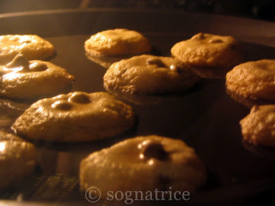 chocolate chip cookies baking in the oven
