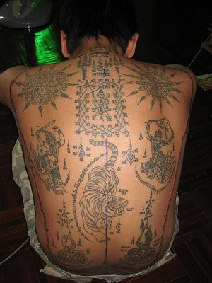 Female tattoo gallery laos tattoos for Laos tattoo designs