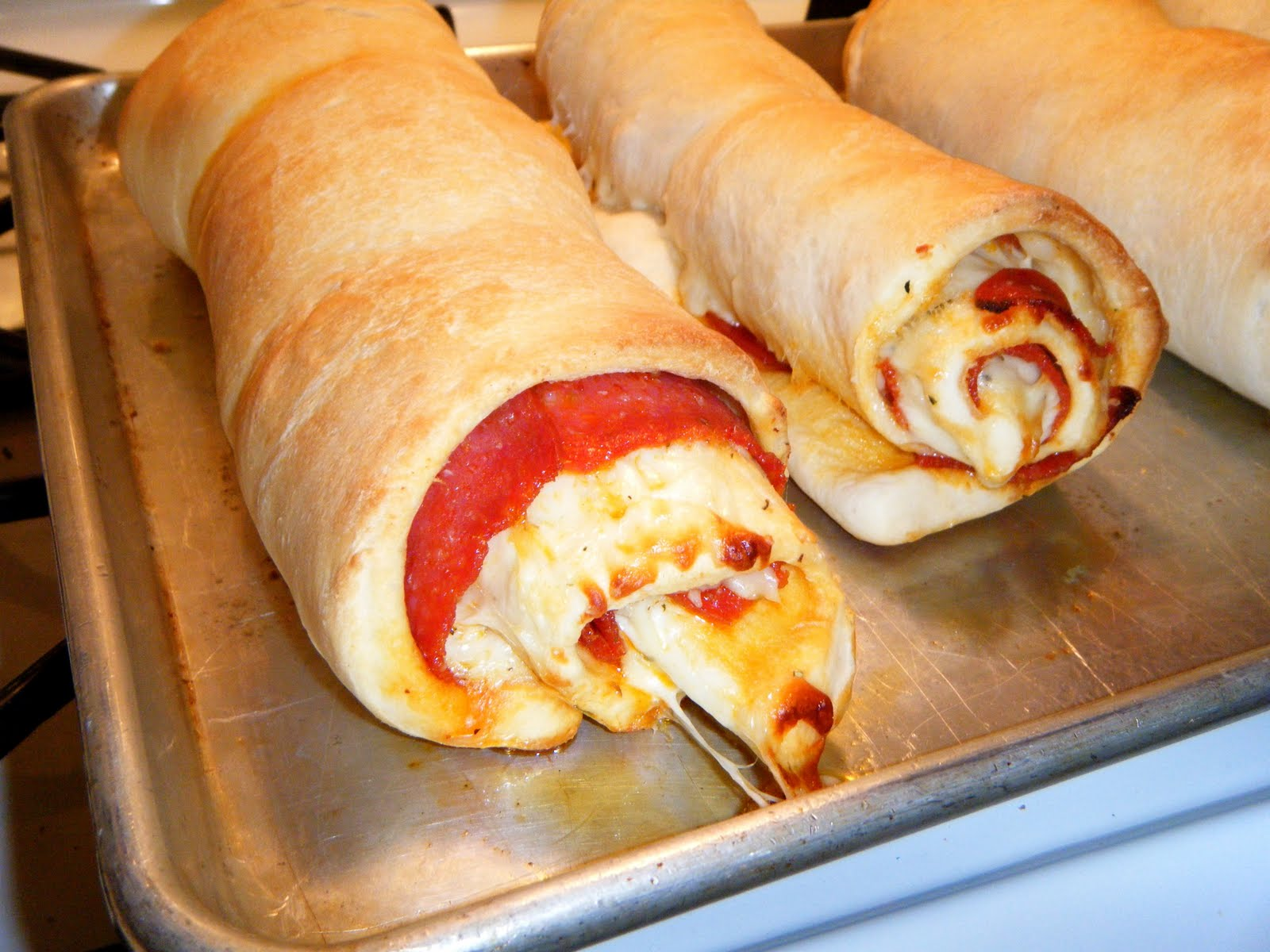 Jun 14, · Spread it out and cover it with the pizza sauce. Cover that with the Mozzarella cheese and then with the Parmesan cheese. Starting from the long end, roll up dough and wrap in parchment. Place in freezer for 15 minutes to chill. Meanwhile, melt the butter in a small bowl. Remove dough log from freezer and slice into 1 1/2″ antminekraft85.tkgs: 8.