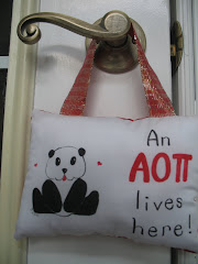 "<a href=""http://www.sororitygifts.etsy.com"">AOII Panda Hang-up Pillow</a>"