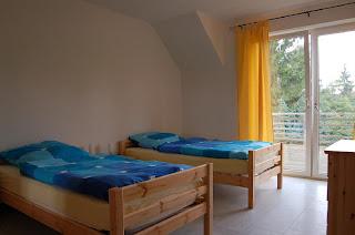 Ferienwohnung Franz Travemünde. Ferienwohnung 1: Schlafzimmer mit Einzelbetten.