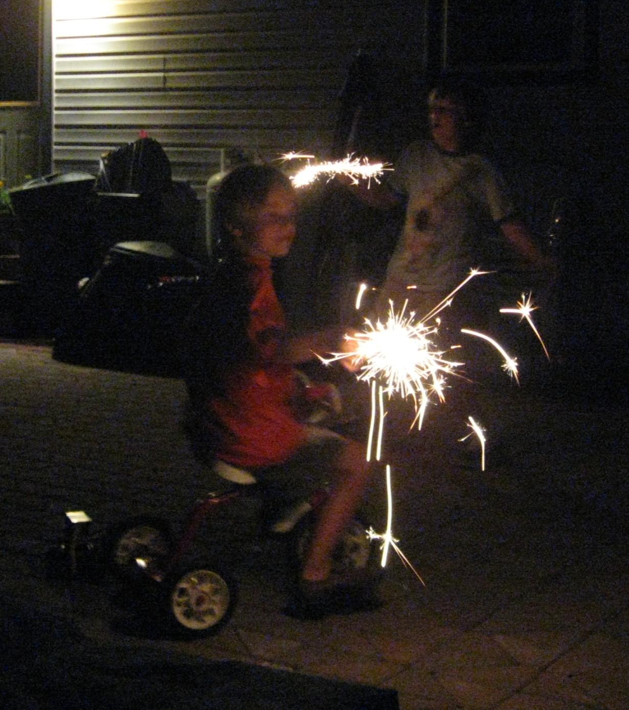 [luke+with+fireworks.jpg]