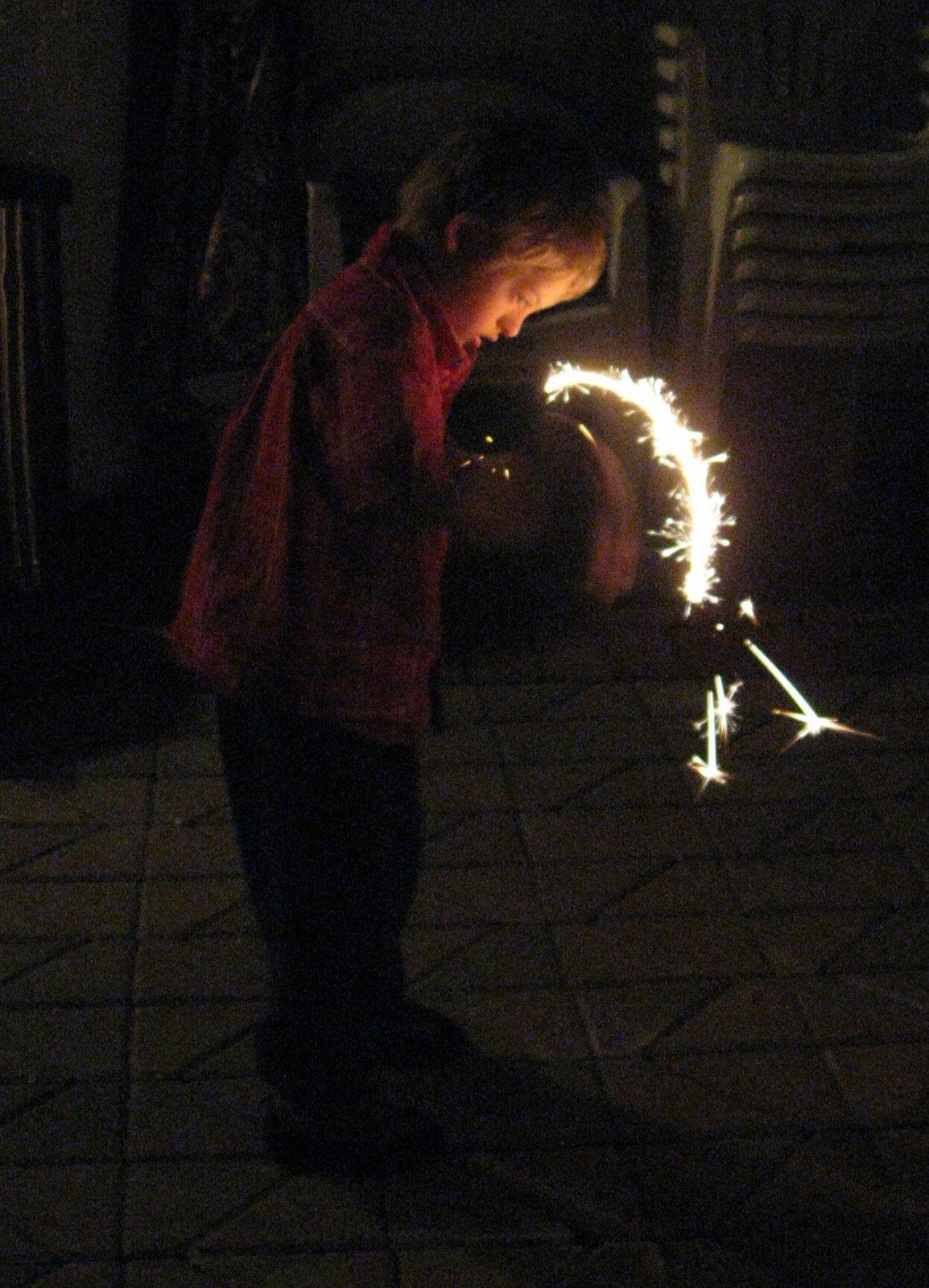[micah+w+sparkler.jpg]