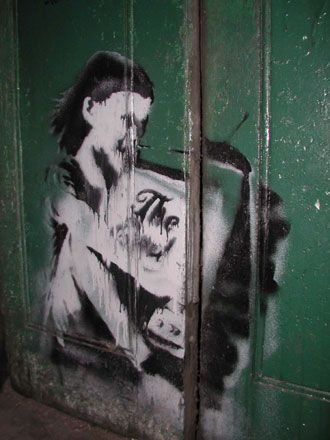 [banksy_girl_tv_330x440.jpg]