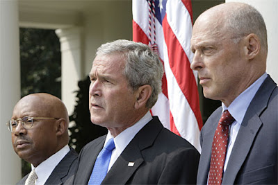 President Bush, center, accompanied by Treasury Secretary Henry Paulson, right, and Housing Secretary Alphonso Jackson, makes a statement on homeownership financing today in the White House Rose Garden.