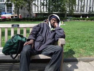 man on urban park bench