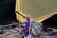 fisherman in Malaysia with his geragau net