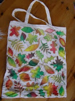 A cotton bag with leaves painted on it