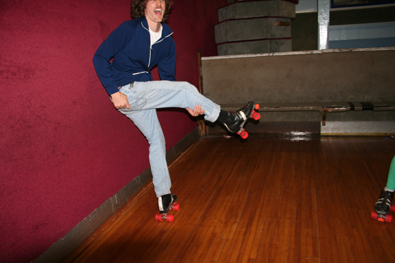 me rollerskating and pretending that my leg is a guitar