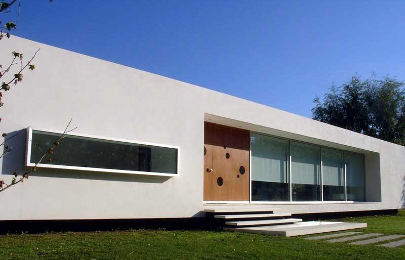 Casa en open door meneghetti arquitectos tecno haus for Casa moderna open