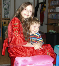 Here's another picture of me, my little brother , and my beautiful red birthday dress.